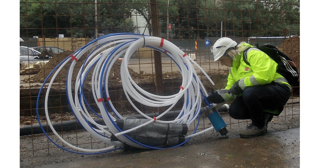 Engineer inspecting GXB-2 Borehole Rod Extensometer before installation on Bucharest Metro