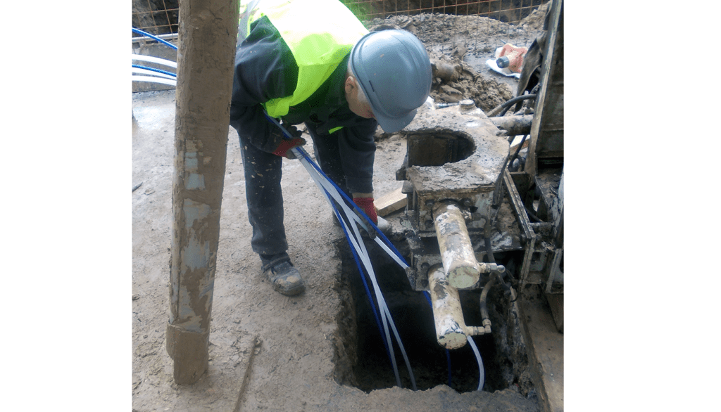 Engineer installing into borehole GXB-2 Borehole Rod Extensometer before installation on Bucharest Metro