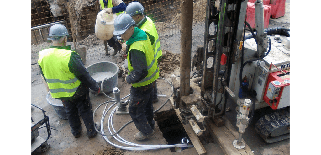 Drillers grouting packer anchors on GXB-2 installation on Bucharest Metro