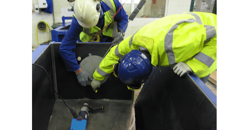 Engineers fitting TPC-4000 cells into concrete section mould
