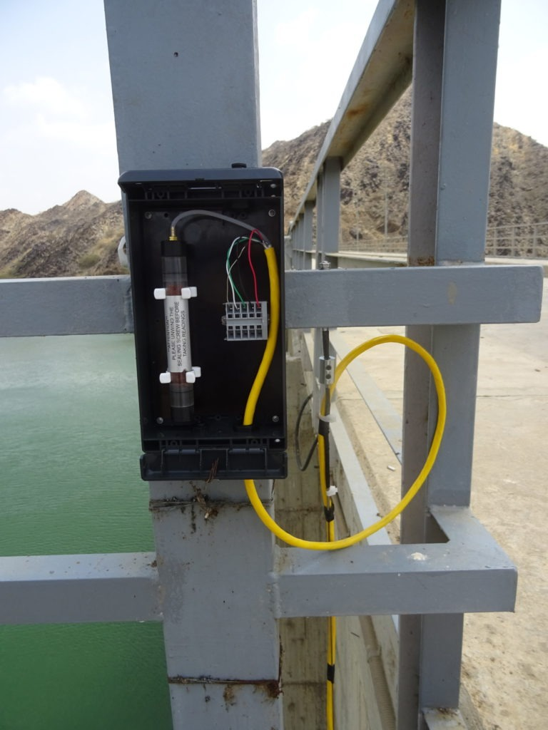 Vented vibrating wire piezometer VWP-3310 mounted in junction box on railing a top of Baish dam