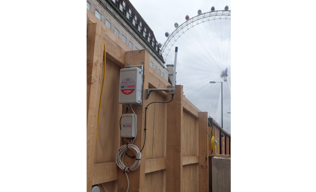 WI-SOS 480 Gateway mounted on site fence post with London Eye in the background