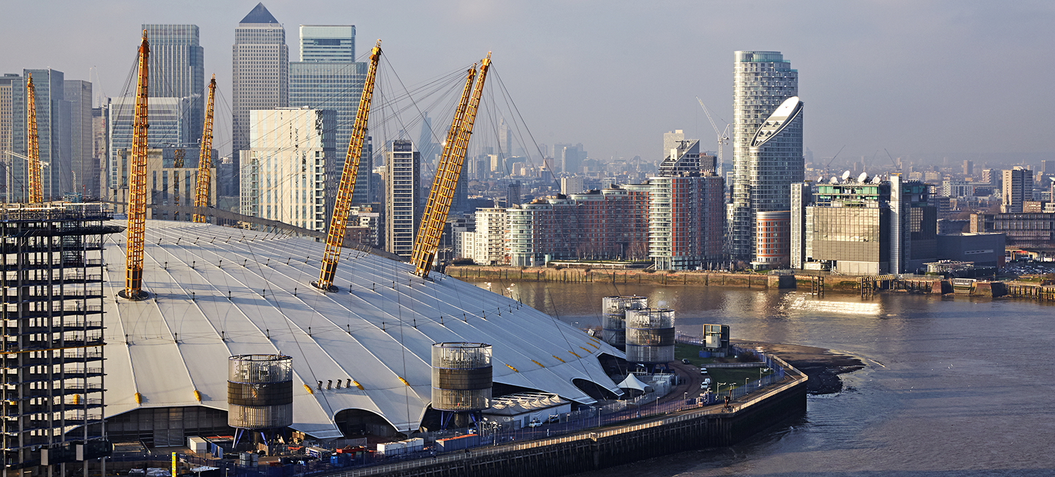 Aerial view of the Millenium Dome, the Thames river with Canary wharf in the background