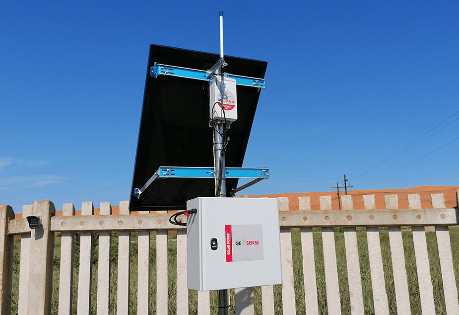 WI-SOS 480 Gateway with solar panel mounted on wooden fence