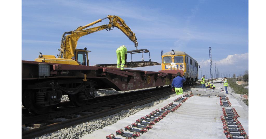 Engineers on rail track installing Total Pressure Cells