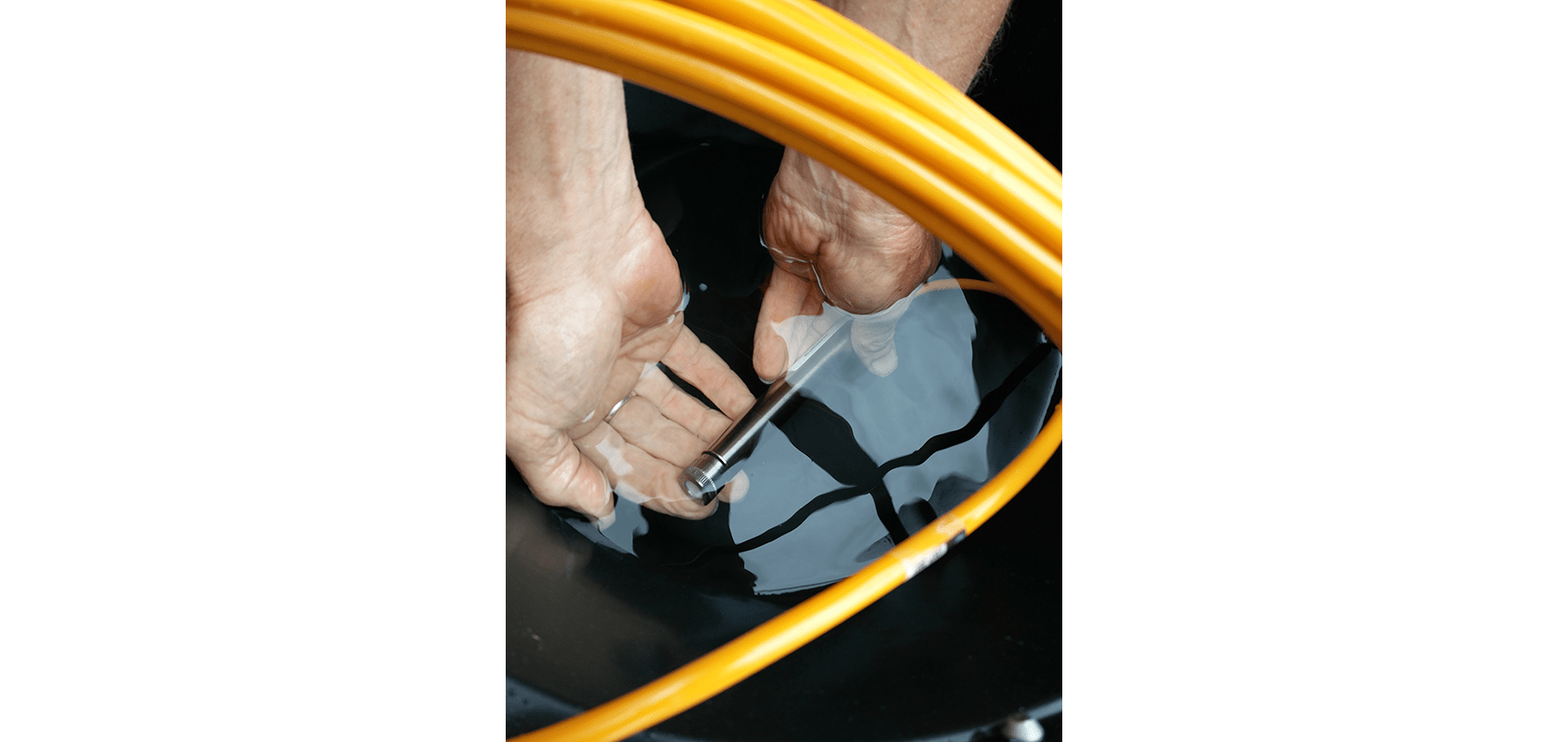 vibrating wire piezometer VWP-300 being saturated in bucket of water