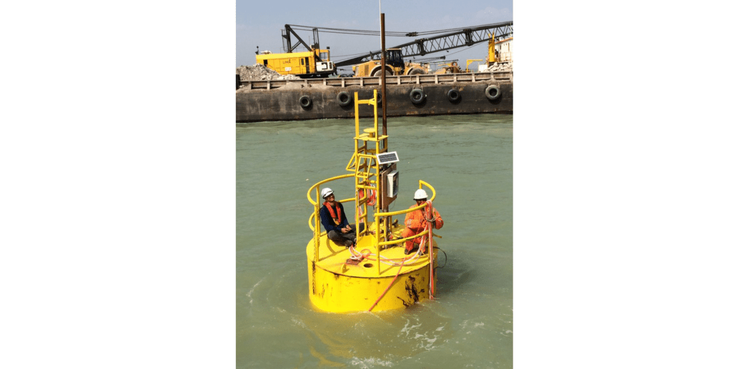 Engineers installing vibrating wire piezometers and wireless Node on floating buoy