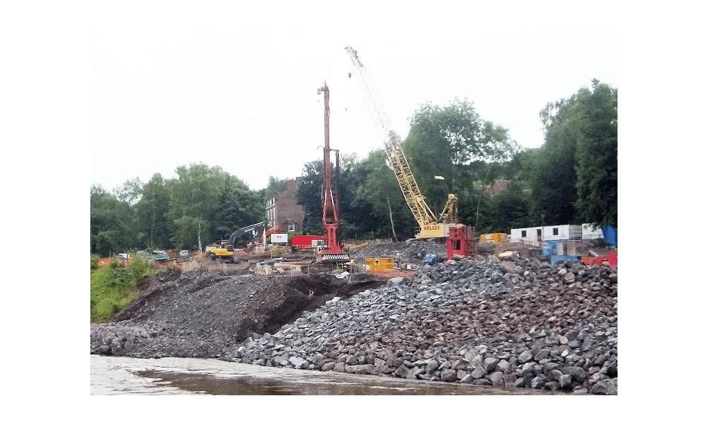 Piling activity along bank of river severn