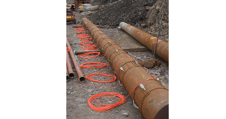Tubular steel piles with VWS-2100 strain gaUGES ATTACHED WITH CABLE COILS ON GROUND