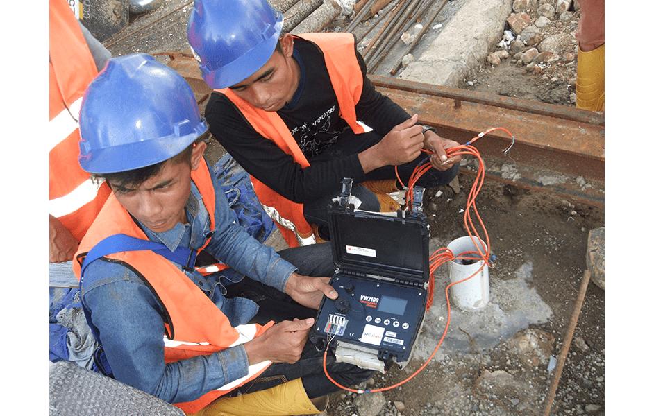 Engineers taking readings of Geosense vibrating wire sister bars on Jakarta Metro