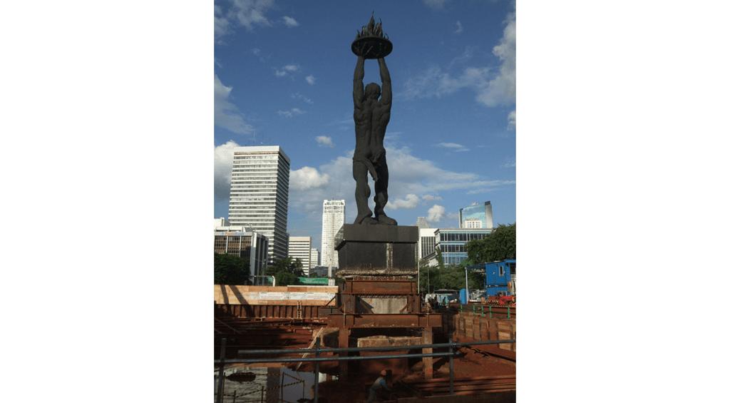 Pemuda Membangun (pizza man) statue in middle of metro construction in Jakarta