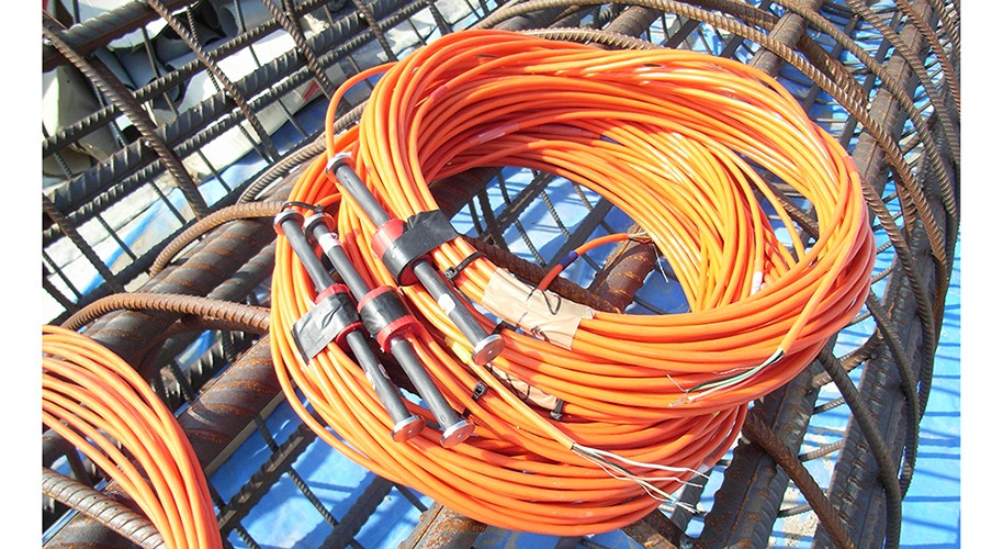 Vibrating wire embedment gauges VWS-2100 with cables sitting on pile cage ready for installation