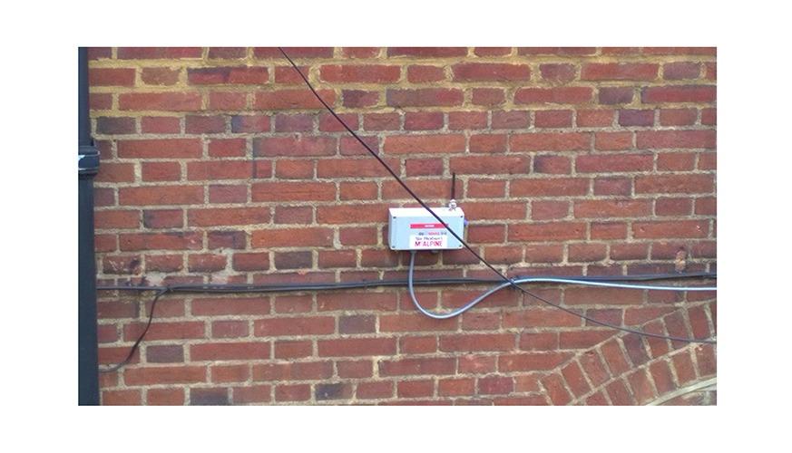 WI-SOS 480 Digital Node mounted on brick wall