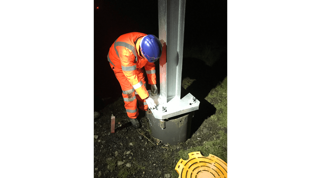 Engineer installing WI-SOS 480 on gantry base on the Chase line