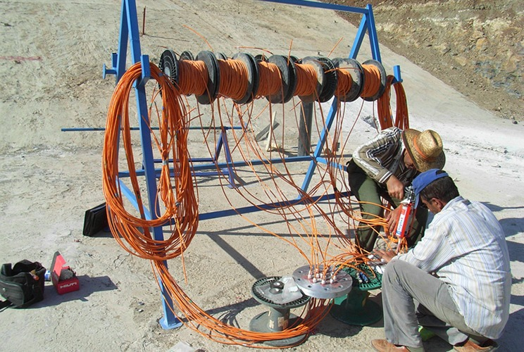Instrument cable reels mounted on frame on dam site