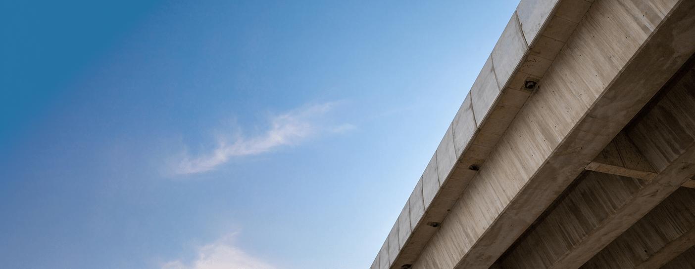 Concrete road bridge deck with blue sky