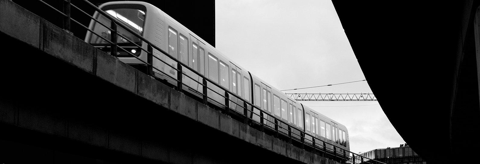 Train running along elevated section of Nordhaven Metro