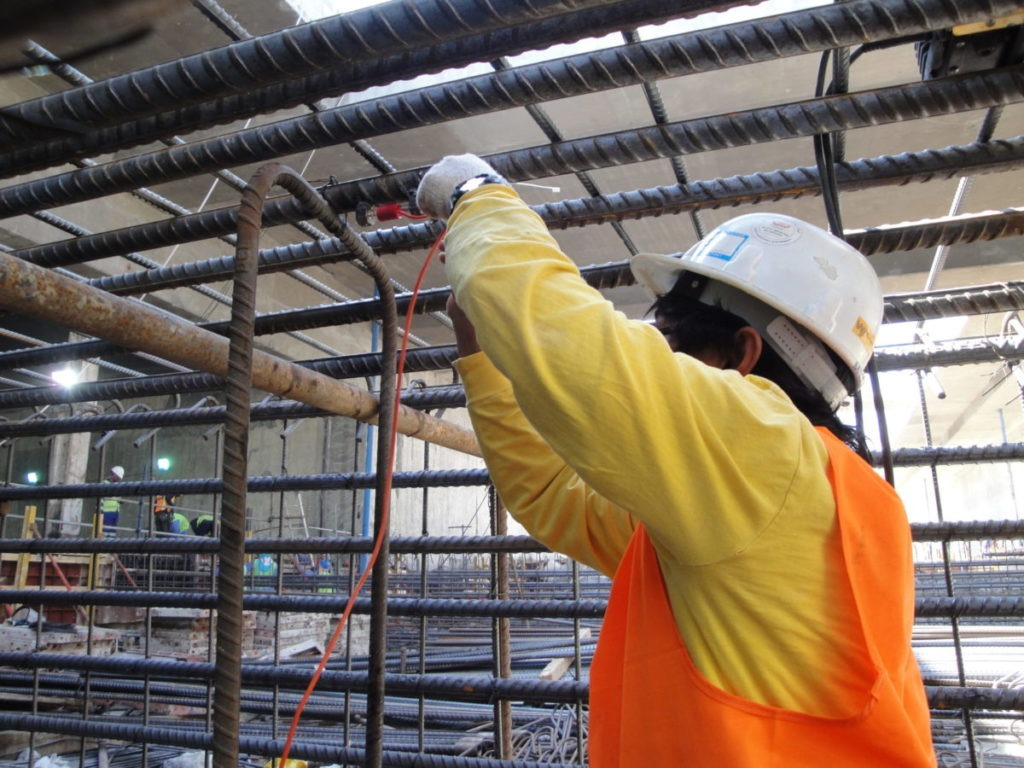Installing VWS-2000 vibrating wire strain gauges on pile cage for Doha Airport construcrtuion