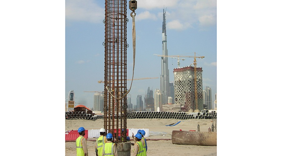 Pile cage being lowered into position with the Burj Al Arab in the background