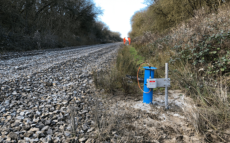 WI-SOS 480 single channel Node for VW piezometer and borehole cover next to rail track